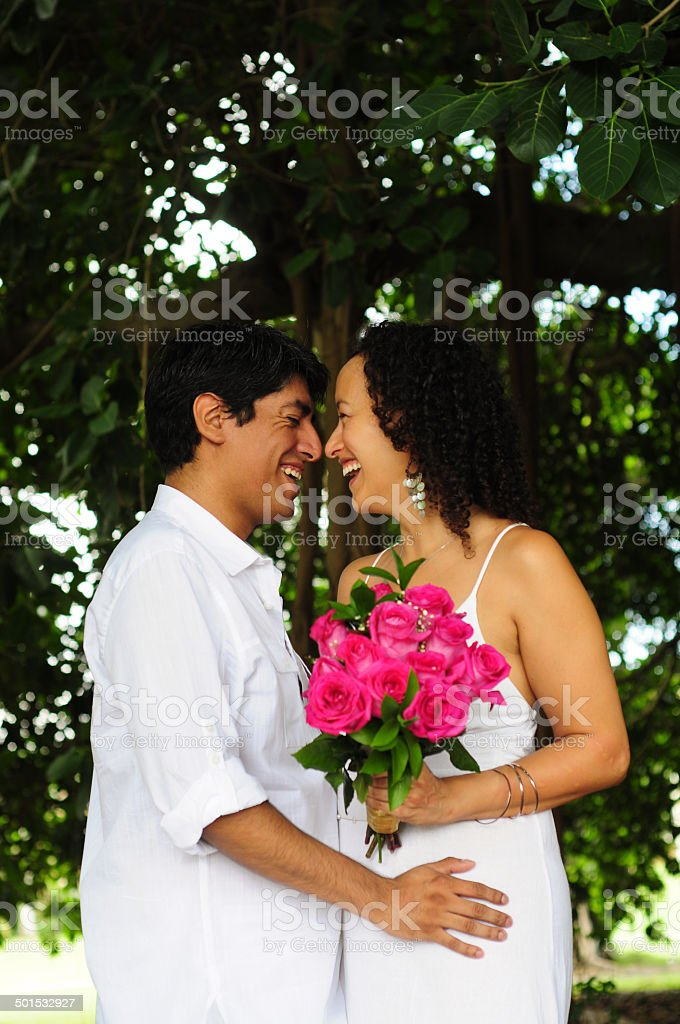 Laughing couple in a forest royalty-free stock photo