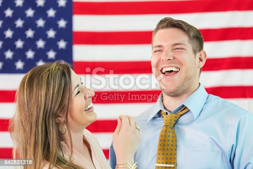 507831144 istock photo Laughing couple in front of American flag 542831318
