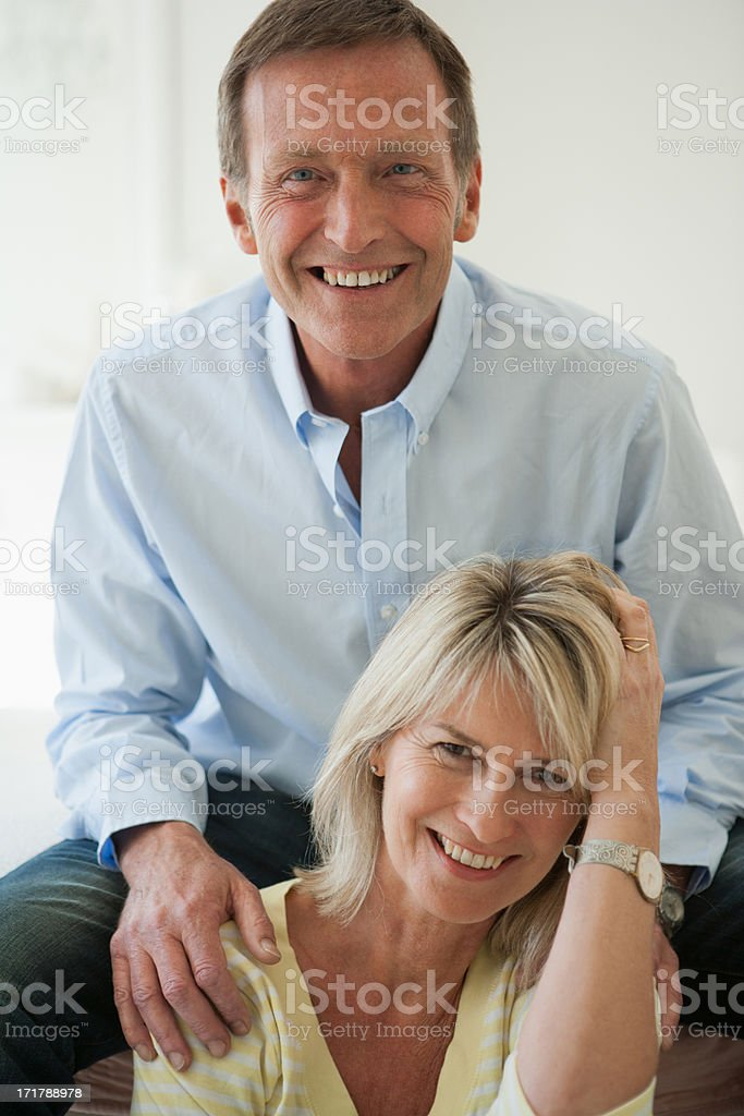 Laughing couple sitting together royalty-free stock photo