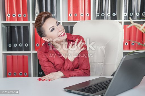 692461598 istock photo Laughing crazy business woman in office 871231794