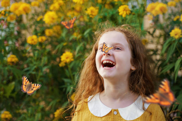 Laughing curly girl with a butterfly on her hair showing white teeth picture id1018972124?b=1&k=6&m=1018972124&s=612x612&w=0&h=zzcisjkvjtgnprmmwairmustdu4mjxol5xwqxefaiwu=