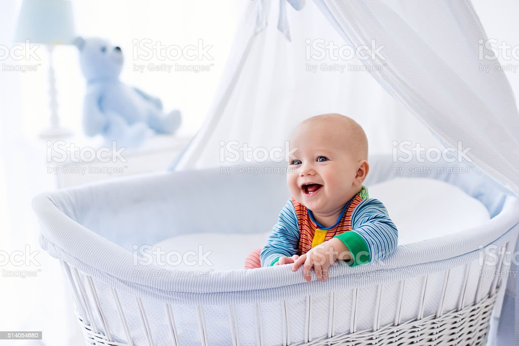 Laughing cute baby in white nursery stock photo