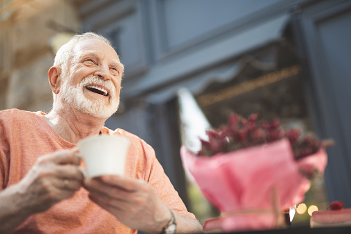Laughing Elderly Man Drinking Tea Outdoors Stock Photo - Download Image Now