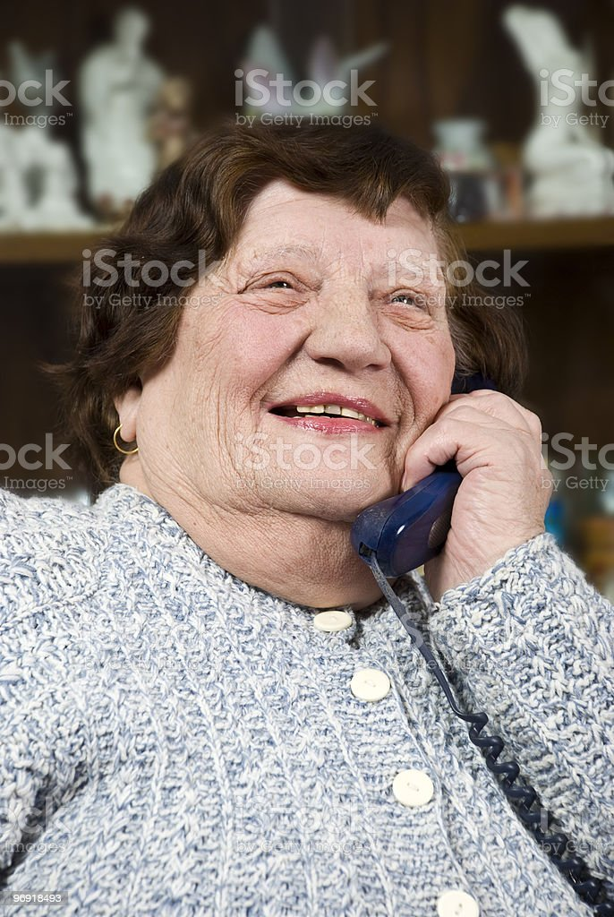 Laughing elderly woman calling by phone royalty-free stock photo