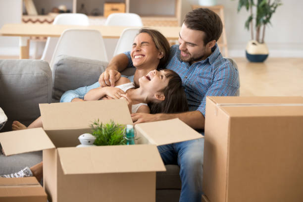 laughing family spend time having fun at new home - tenant stock photos and pictures