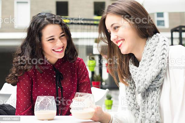 Laughing friends and coffee