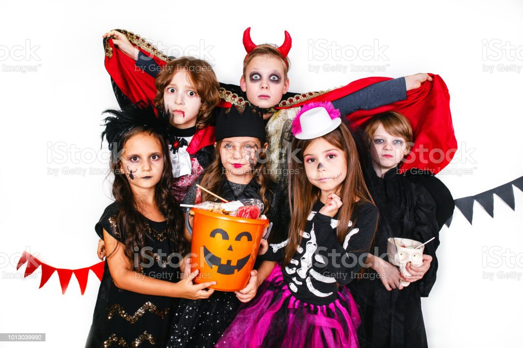 Halloween Costume 303.Laughing Funny Children In Costumes In Halloween Stock Photo