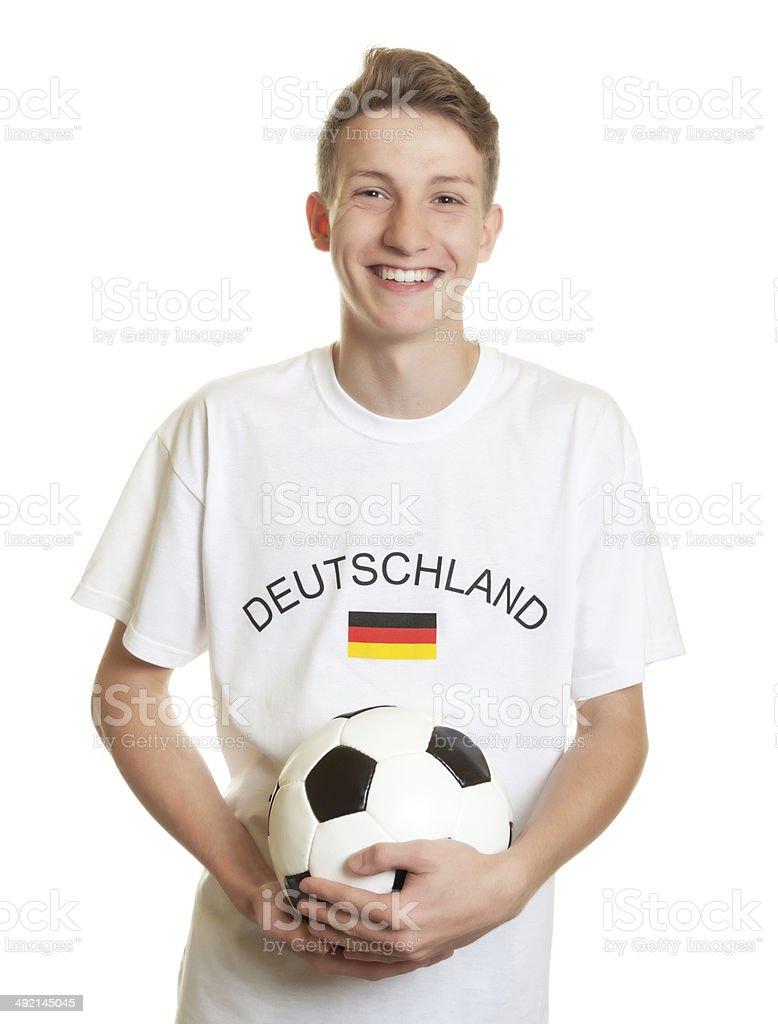 Rindo fã do futebol alemão com cabelo loiro e controle de bola - foto de acervo