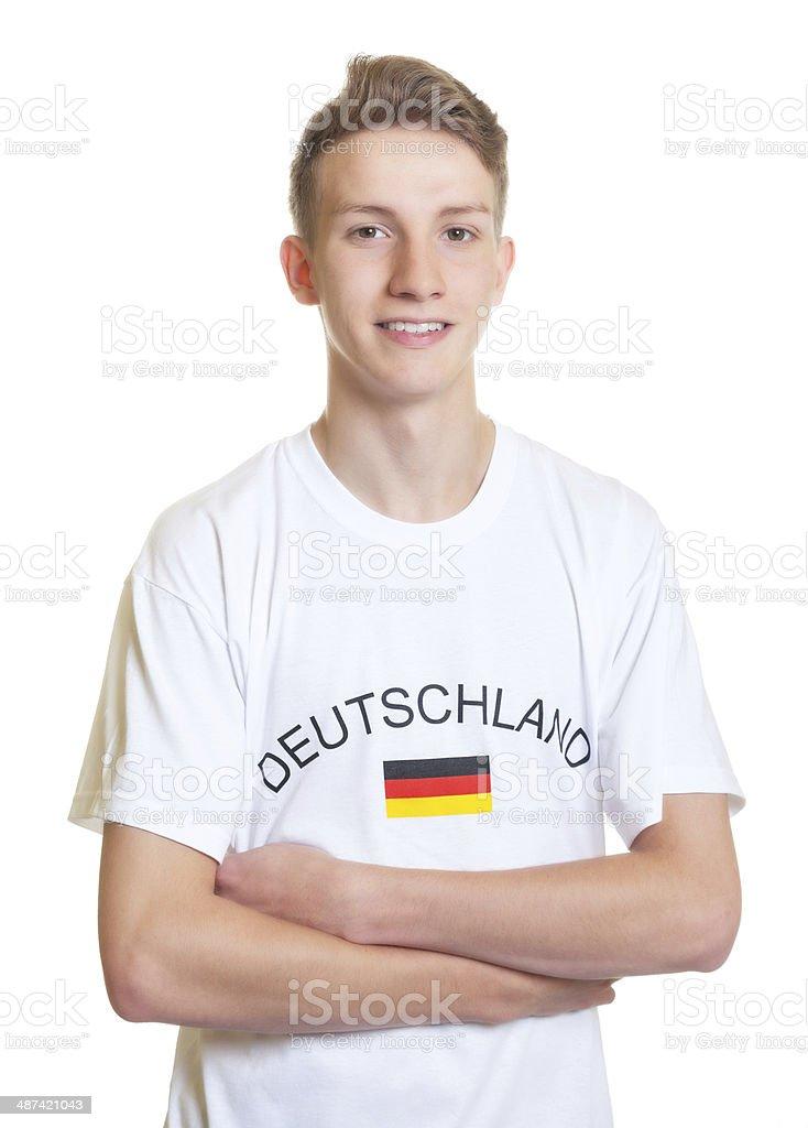 Rindo alemão fãs de esportes com braços cruzados e Cabelo Preto - foto de acervo