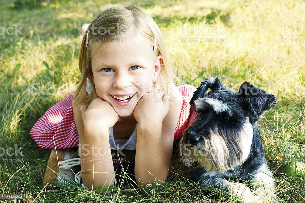 laughing girl and her trusty miniature schnauzer royalty-free stock photo