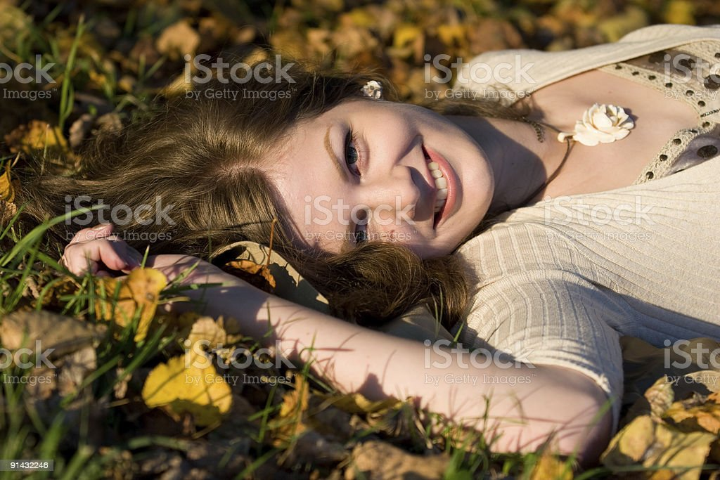 Laughing Girl in autunm leaves royalty-free stock photo