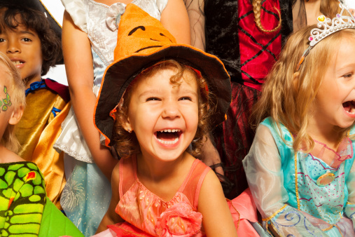 istock Laughing girl in Halloween costume with friends 513606355
