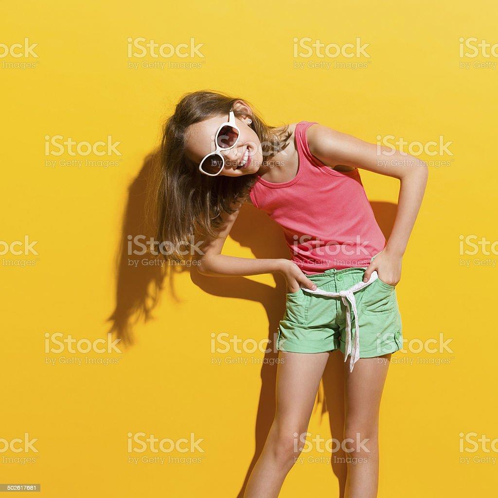 Laughing girl in sunlight stock photo