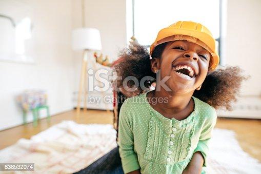 istock Laughing girl 836532074