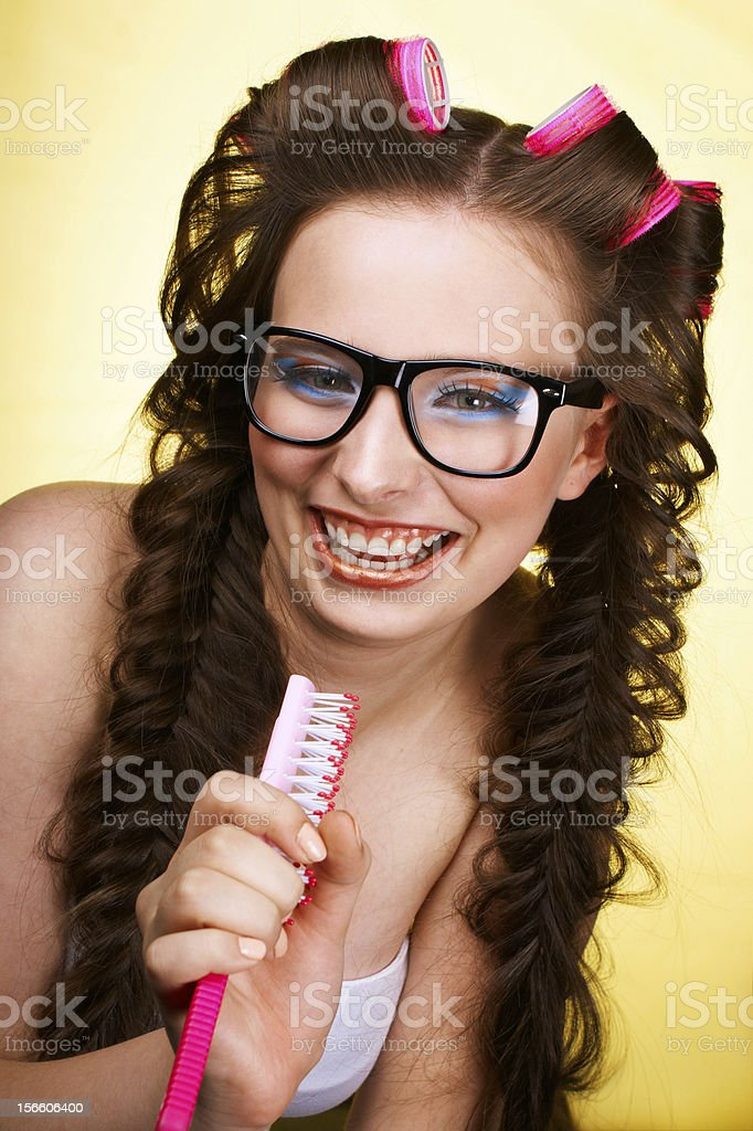 Laughing girl with a hairbrush royalty-free stock photo