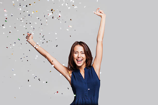 laughing girl with falling confetti at party - gute geschenkideen stock-fotos und bilder