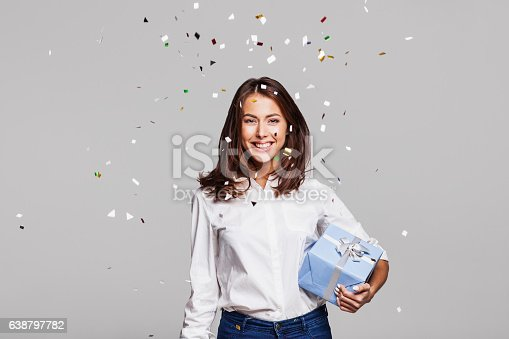 istock Laughing girl with falling confetti at party 638797782