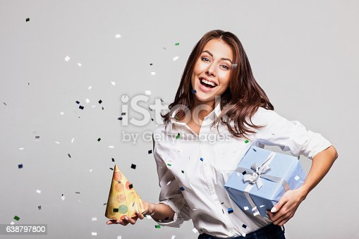 627933752istockphoto Laughing girl with falling confetti at party 638797800