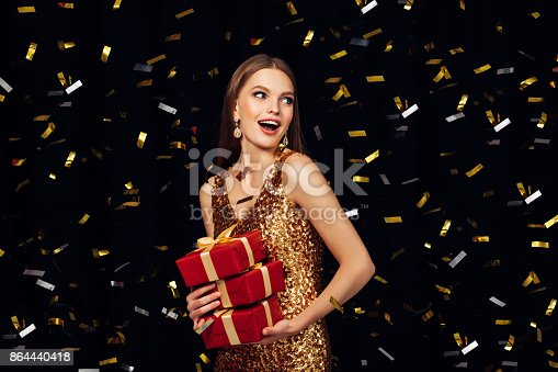 627933752istockphoto Laughing girl with falling confetti 864440418