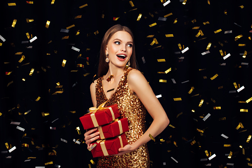 627933752 istock photo Laughing girl with falling confetti 864440418