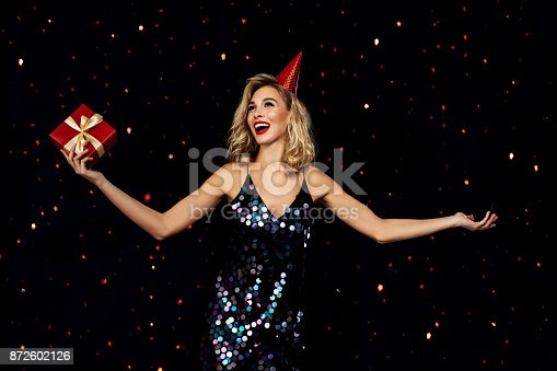 627933752istockphoto Laughing girl with falling confetti 872602126