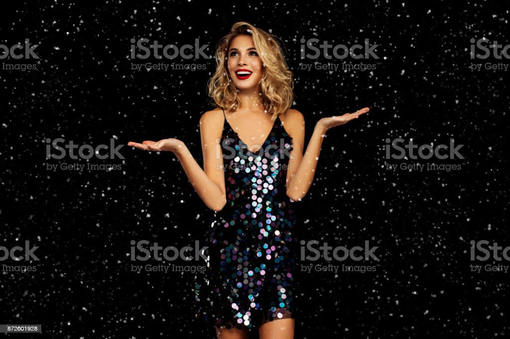 Laughing girl with falling snow stock photo