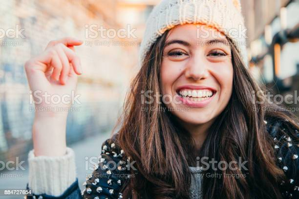 Laughing Girl With Woolen Cap Stock Photo - Download Image Now