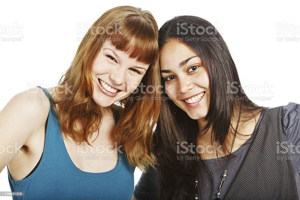 Laughing girlfriends share a joke royalty-free stock photo