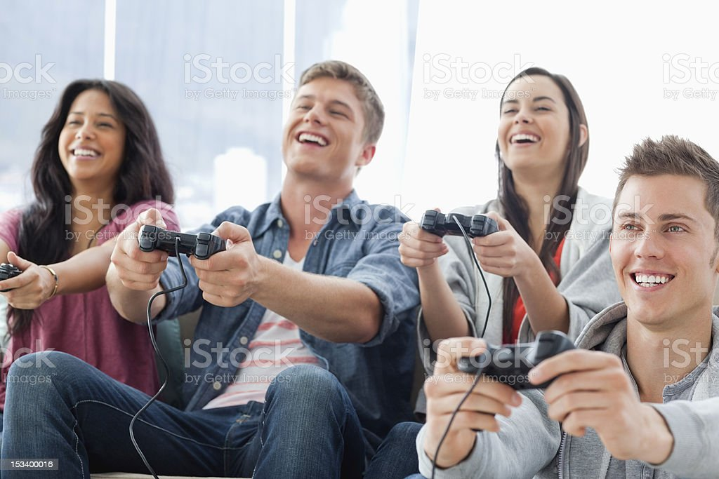 Laughing group enjoying games together royalty-free stock photo