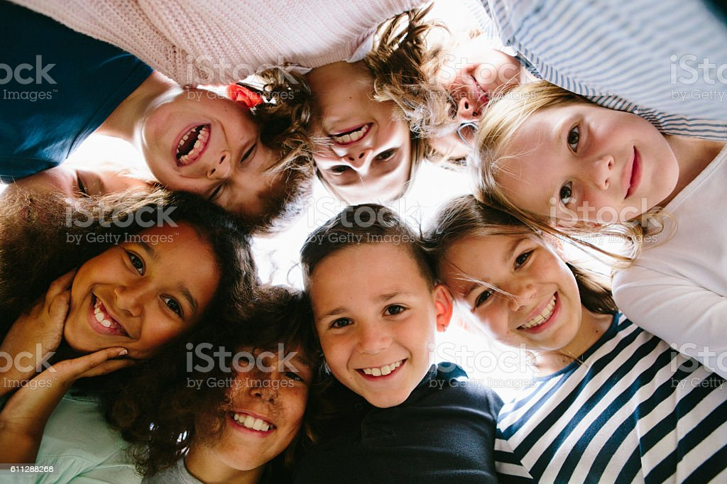 laughing group of kids in circle stock photo