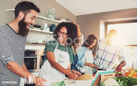 istock Laughing group of young cooking students 905590538