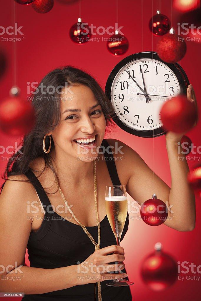 Hispanic woman celebrating New Year with Champagne.