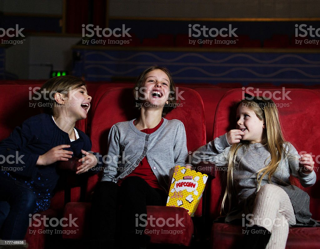 Laughing in the cinema royalty-free stock photo