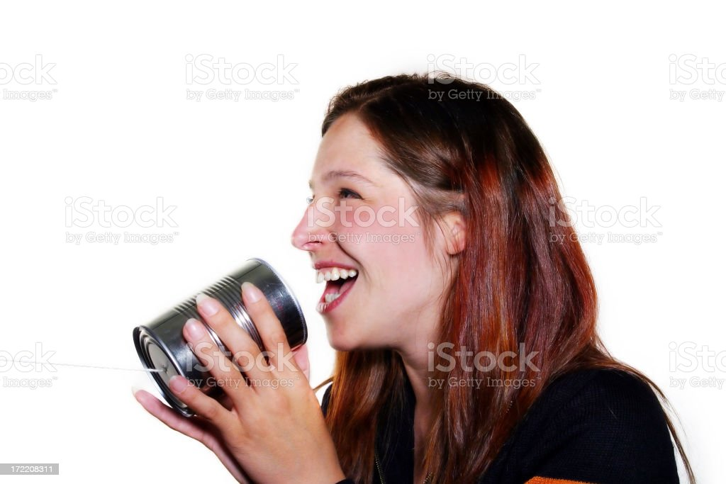 Laughing into a tin can phone royalty-free stock photo