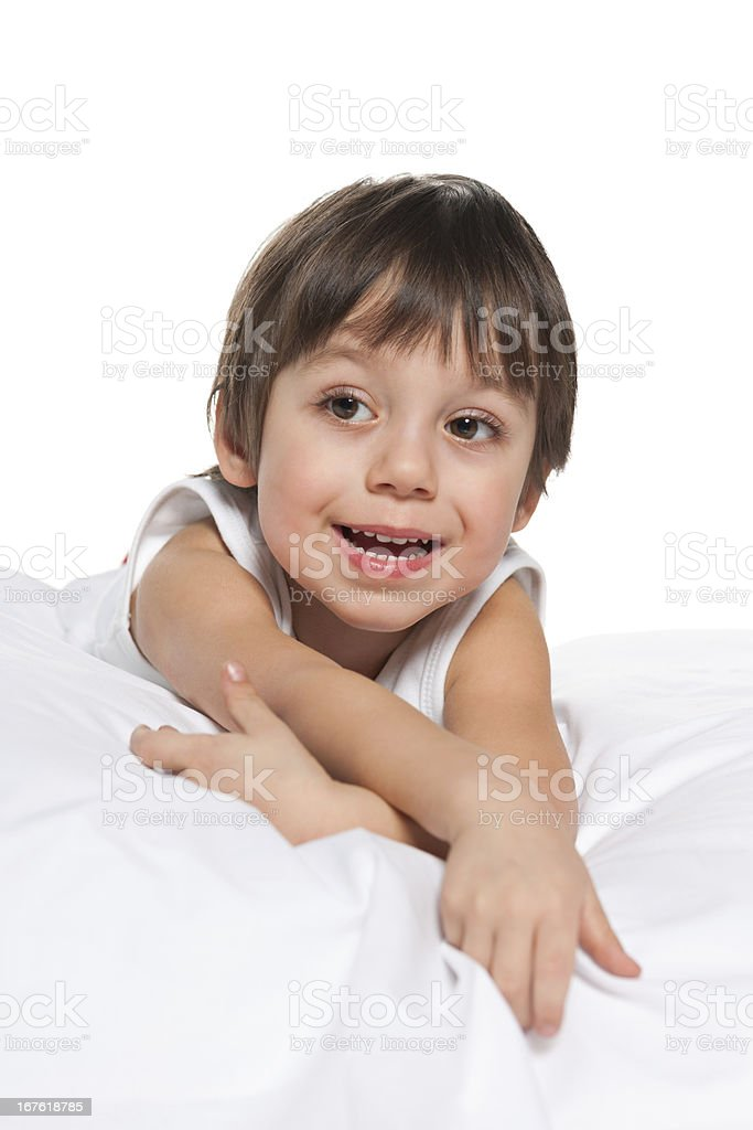 Laughing little boy on the white royalty-free stock photo