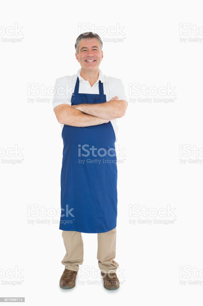 Laughing man dressed in apron stock photo