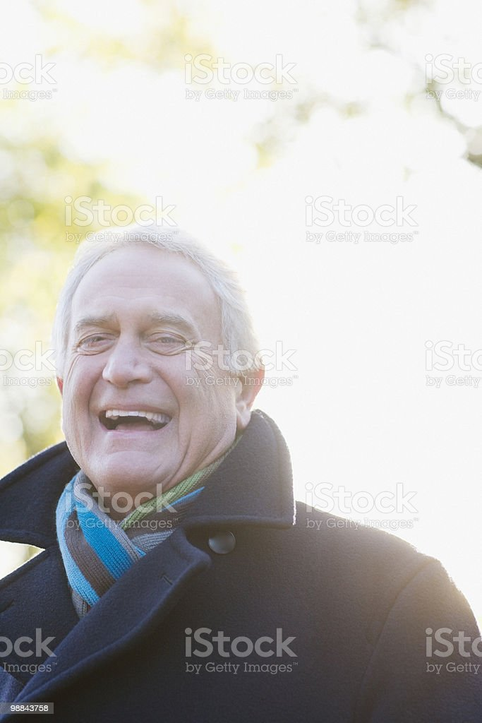 Laughing man outdoors in autumn royalty-free stock photo