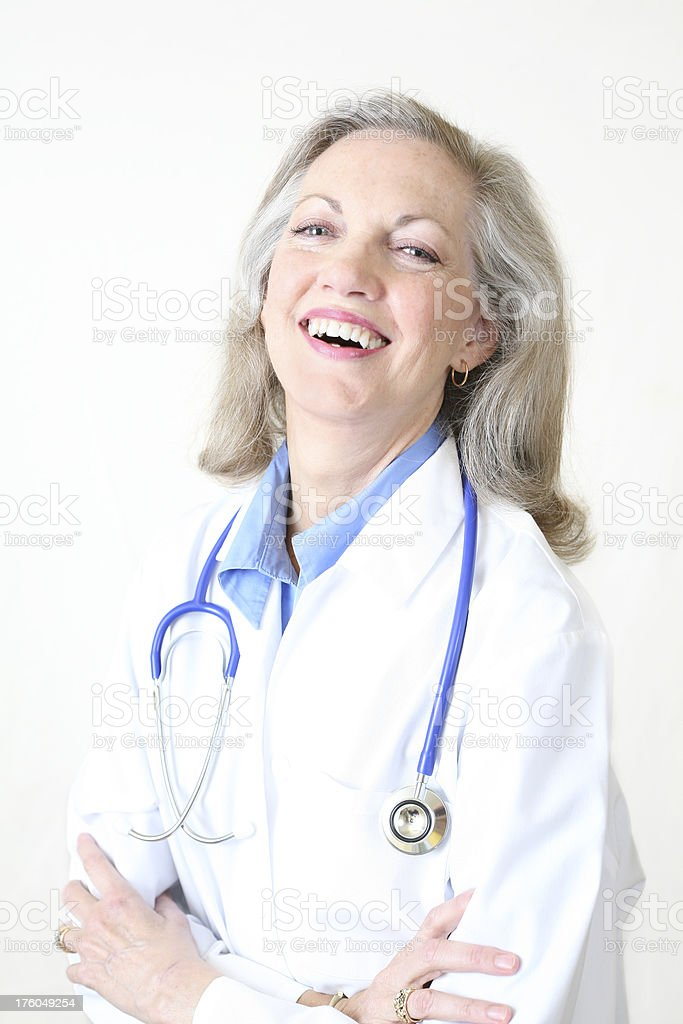 Laughing Mature Adult Doctor on a White Background royalty-free stock photo