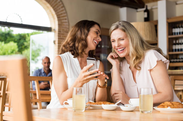 Laughing mature friends stock photo