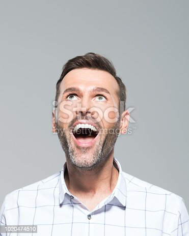 istock Laughing mature man looking up 1020474510