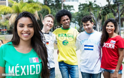 istock Laughing mexican sports fan with supporters from Russia, Brazil, Argentina and Germany 890589280