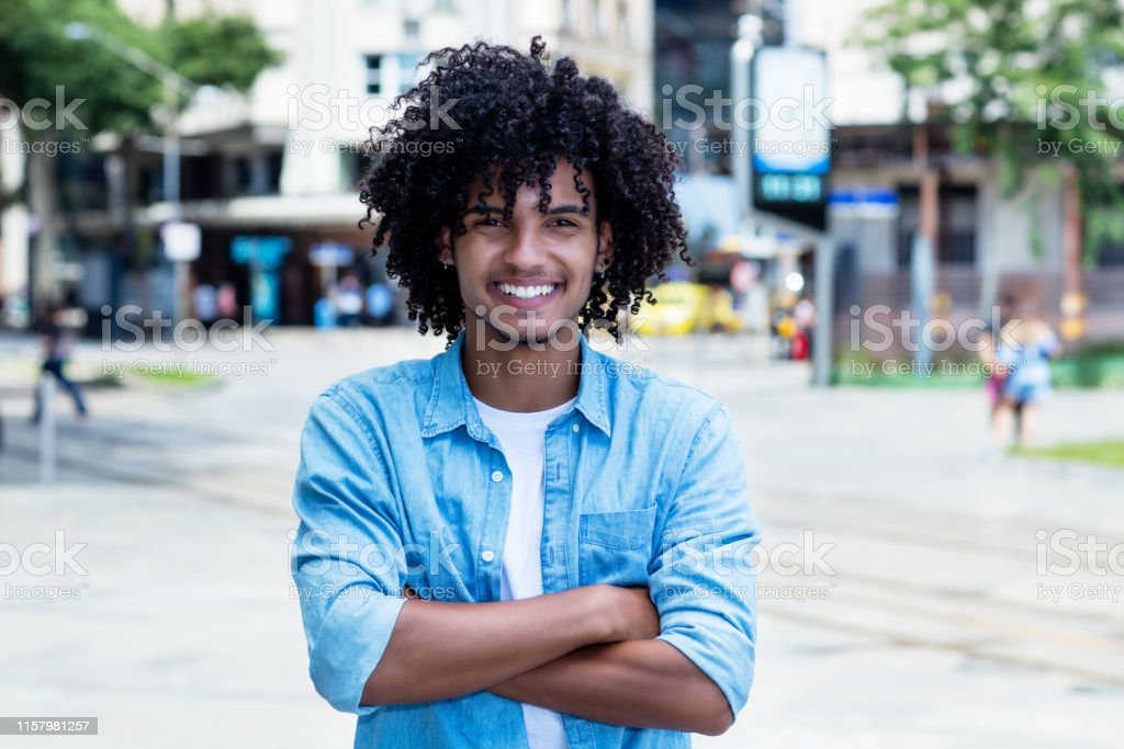 Outstanding Laughing Mexican Young Adult Man With Long Curly Hair Stock Photo Schematic Wiring Diagrams Phreekkolirunnerswayorg