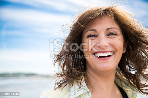 istock Laughing middle aged woman 815200634