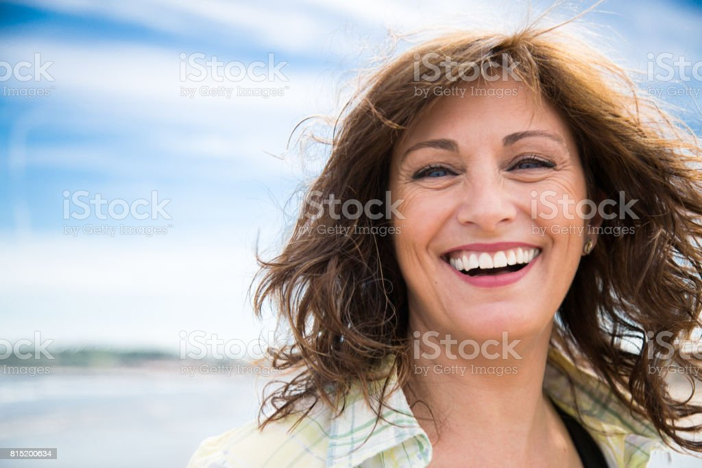 Laughing middle aged woman stock photo