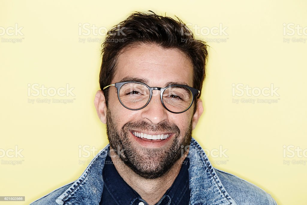 Laughing model with stubble and glasses, portrait foto stock royalty-free
