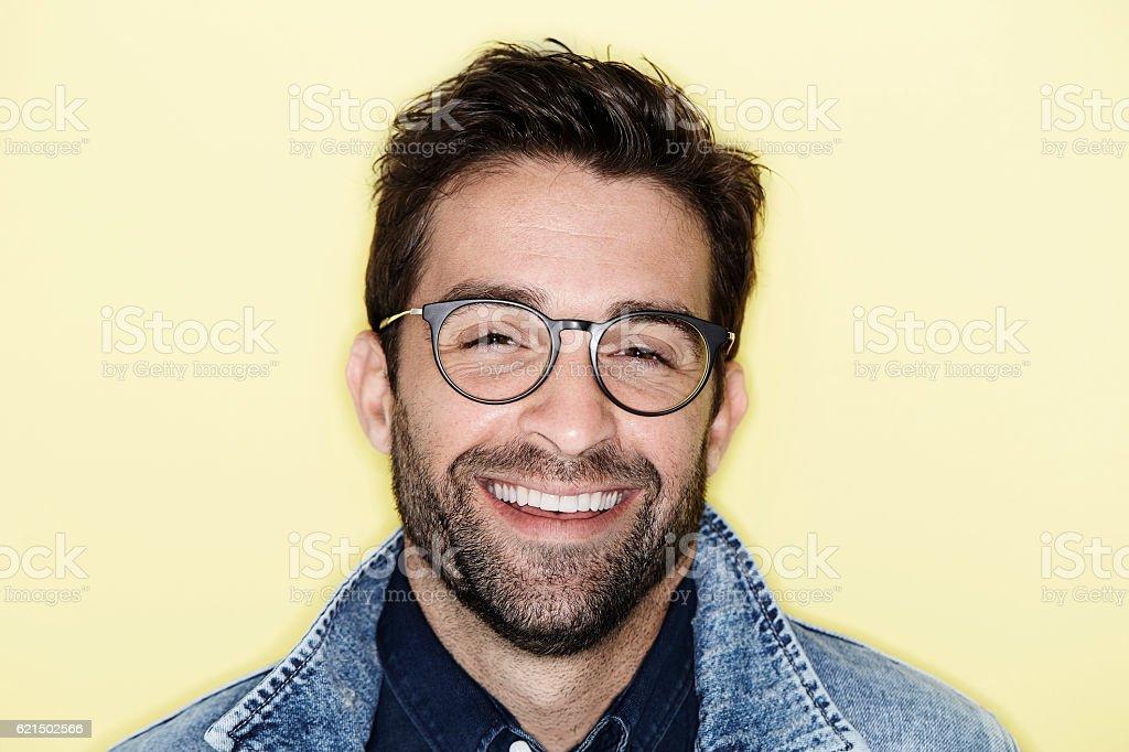 Laughing model with stubble and glasses, portrait photo libre de droits