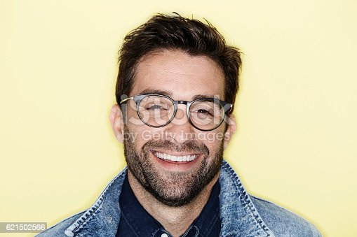 649754038 istock photo Laughing model with stubble and glasses, portrait 621502566