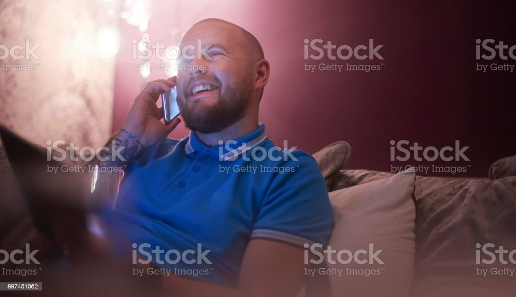 Laughing on the phone stock photo