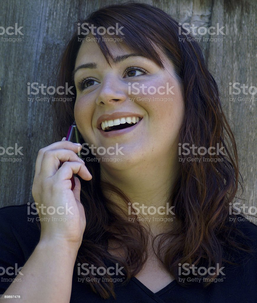 Laughing on the phone royalty-free stock photo