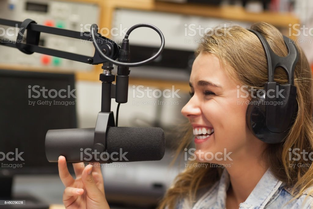 Laughing pretty radio host moderating stock photo
